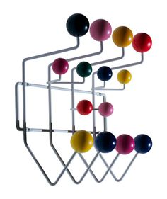 Ray Eames designed a variety of toys and furniture pieces specifically for children, including this wall-hung coat rack in 1953 for Tigrett Enterprises Playhouse Division. It was reissued by Herman Miller in 1994.