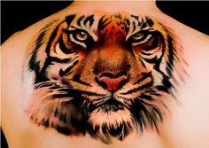 http://www.myperfecttatoo.com/tiger-tattoos-design-ideas/