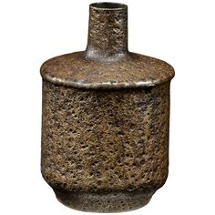 Heavily textured round brass vase with a dark patinated finish, the shallow base…