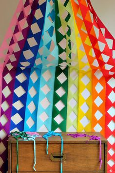 Bright DIY rainbow garland to cover an entire wall. #ASubtleRevelry