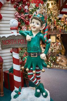 Elf with North Pole sign Luxury Christmas Tree, Merry Christmas To All, Christmas Store, Little Christmas, All Things Christmas, Christmas Holidays, Christmas Wreaths, Christmas Ornaments, Elf Decorations