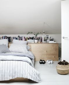 Layers of textiles in a minimal bedroom.