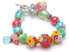 Bollywood Bracelet, Lampwork Beads Flowers, Lotus, Orange Yellow, Blue, Green Roses, Blossoms via Etsy