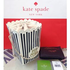 "Kate Spade Cinema City Popcorn Bucket Bag Clutch RARE AND SOLD OUT! Kate Spade New York Cinema City Popcorn Bucket Hand Bag Comes with original dustbag, booklet, and price tag. Good overall condition - shows some signs of wear. Approx measurements:  8""h x 6""w x 6""d at the top of the bag (tapers down to 4""w x 4""d at the base) Handle drop length: 4"" Printed patent cowhide leather with patent trim 14-karat light gold plated hardware Handheld with drawstring closure Interior slide pocket KSNY…"