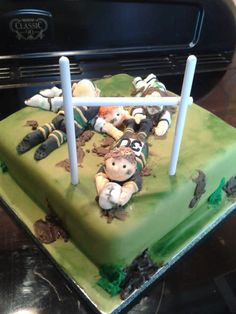 This cake was made today for a Rugby mad fella who is going to be 30. The players are dress in kit to represent The Northampton Saints V's Leicester Tigers (Tigers are in away kit). The cake is Chocolate Fudge.