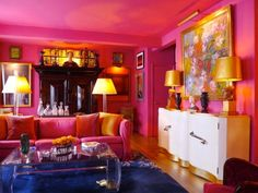 Designer Sam Botero's Upper East Side living room is not messing around with hot pink — walls, ceilings, and doors.