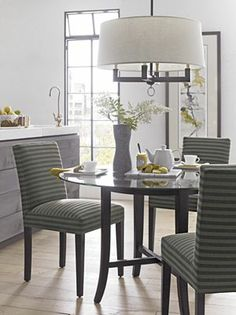 """Halo Ebony Dining Table with 42"""" Glass Top.  I like the glass top table, not so crazy about the chairs."""