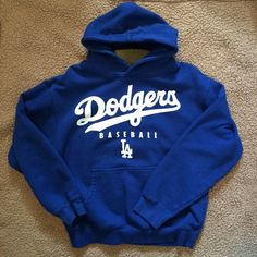 LA Dodgers Hoodie Very cute and comfortable Los Angeles Dodgers Hoodie! No flaws. Bought and only wore it twice! Kids L so fits Women's XS-S!  Tops Sweatshirts & Hoodies
