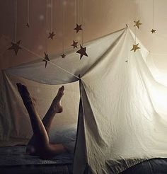 make a tent out of an old sheet and hang some gold tinfoil stars from the ceiling, and you've got yourself a glampout!