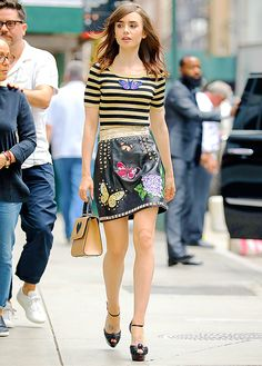 Lily Collins spotted walking around in a stylish outfit in NYC on July 25th, 2017.