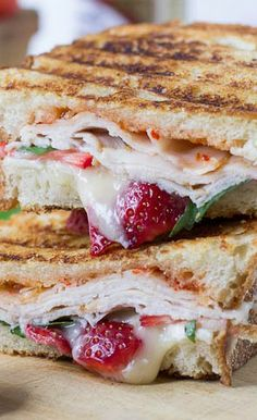 Strawberry, Brie, and Turkey Panini - There are so many incredible flavors going on in this Strawberries, Brie, Smoked Turkey, Fresh Basil, and Red Pepper Jelly Panini.