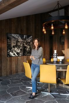 """Cox in her dining room; the table, chairs, and chandelier are all for sale. """"I've been going to a lot of flea markets,"""" the actress says. """"My boyfriend lives in London, so I've been going to England a lot—I've probably been six times in the last eight months—and any little towns outside London are fantastic. It's really easy to find things there that you have to be a scavenger for at the flea markets here."""""""