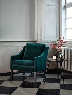 Dark green velvet Lounge Chair 2207 by Børge Mogensen. Beautiful craftsmanship. Designed in 1963 as part of a series including a 2 and 3 seater sofa. Produced by Fredericia. Danish furniture design.