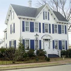 An old Federal style house in Smyrna, Delaware. Love the pop of the Persian Blue shutters against the white siding. Add a red front door and I'm set. Exterior Paint Colors, Paint Colors For Home, House Colors, Exterior Design, Style At Home, Navy Shutters, Federal Style House, White Siding, House Front