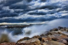 'Breakwater Holland Michigan' Fine Art Photography by Evie Carrier Beautiful blues mix in the skies, wonderful splash in Lake Michigan. Extraordinary Photography by Evie. Choose your print size, mat and frame.