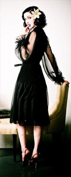 Those sleeves! I need a black dress with sleeves like that. I just do.