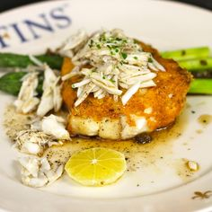 Delicious New Orleans Parmesan Crusted Flounder with Jumbo Lump crab, asparagus, crispy capers, Meyer lemon, brown butter.