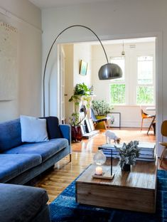 """Sneak Peek: Arran Russell and Jacqui Lewis. """"The lounge is an old Cassina Jac has had for years that we recently dyed charcoal, although it looks quite blue in this shot due to the rug. The rug is from my sister, who bought it for us in Iran as a gift when she was living there; it's 400-year-old segments stitched together and overdyed. The coffee table is by Oishi, an Australian company, and the lamp is an original Arco."""" #sneakpeek"""