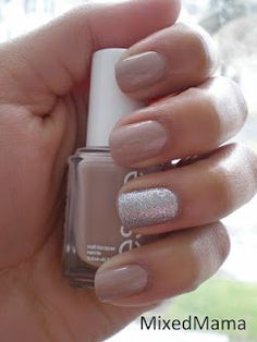 """""""Brooch the Subject"""" by Essie along with four coats of """"Beware"""" by Pure Ice on the ring finger."""
