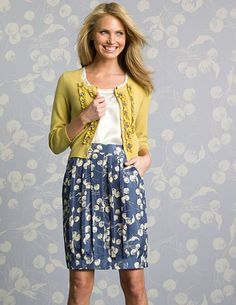 love these colors. bright yellow cardigan with blue silk skirt--so cute!