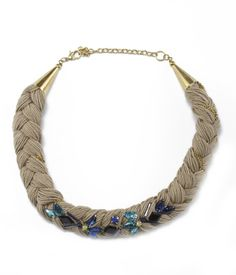 Women's chunky braided necklace featuring a placed cabochon design in hues of blue.
