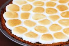 You will love this delicious S'mores Pie recipe. It's chocolate-y, marshmellow-y deliciousness presented in the form of a decadent pie.