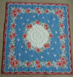 Raspberry and White Floral quilted vintage tablecloth.