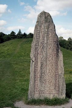 "Viking runestone. The runes say: ""Folkvid raised all these stones for his son Heden, Anunds brother. Knob cut the runes."""