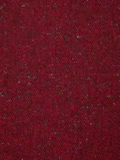 Redcurrant Revelry - Donegal Tweed Herringbone £30.00 / per metre Rich, deep, red tones are woven throughout this outstanding Donegal Tweed Herringbone. The colours are rich and warming, like ripe red fruits or a hot spicy mulled wine, and interspersed with a sprinkling of jewel-like Donegal flecks in emerald green, turquoise, tomato red and soft lilac. All these extraordinary colours are grounded by the signature charcoal Herringbone weave within the fabric.