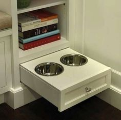Pet Drawer  Despite attempts to hide them away, pet dishes always seem to linger in plain sight. No more! When meal time is over, you can slide this pull-out drawer from Plain & Fancy back into the wall, completely concealing Fido's dining area.