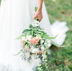 Make This Look!   Flowers By: Joy ♦ Palm Bay, FL      Looking like the overgrown garden of my dreams, this bride featured an array of textures, heights, and blooms for the perfect fresh-picked look. Clusters of Daisies, Spray Roses, Larkspur, and Button Poms will stand out against the soft Fern greenery, which serves as a delicate, lush background. Creating a wildly romantic look couldn't be easier with this bride's choice of flowers!