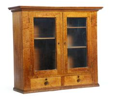 """Garth's Sale 1119 Lot 450 9/6/014.  TABLE-TOP CUPBOARD. Attrib. to Zoar, Ohio, mid-late 19th c., curly maple & poplar. Heavily constructed, with 2 glazed doors over 2 drawers. Retains an old finish & original pulls. Good condition overall. Surface wear throughout. Missing escutcheons. JC 8-29-14.  38""""h. 43""""w. 14""""d. Such a cupboard in the Zoar community was referred to as a glas kastlein. For related examples, see Snyder, Goud, and Goudy, Zoar Furniture, 1817-1898, pp. 62-66. Est: $…"""