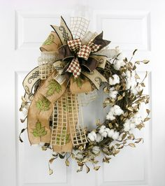 The synthetic cotton on this grapevine wreath design looks freshly picked ready for your fall decor. Tied with a Terri Bow with embroidered burlap leaf ribbon and other complimentary silk and burlap r
