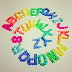 Rainbow ABC perler beads by Asami Nagasaki Perler Bead Designs, Hama Beads Design, Pearler Bead Patterns, Diy Perler Beads, Perler Bead Art, Pearler Beads, Hamma Beads Ideas, Pixel Beads, Art Perle