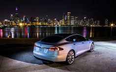 Tesla Motors Inc., the electric-car make, showed a battery swapping system for its Model S sedan that's faster than charging and ens...