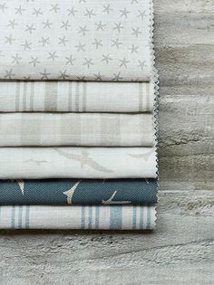 Peony and Sage - Coastal Fabric Collection - Folds of six different fabrics with checks, bird prints, star prints and stripes in light grey, beige, white and dark blue Coastal Bedrooms, Coastal Living Rooms, Coastal Cottage, Coastal Homes, Coastal Style, Coastal Decor, Beach Homes, Cottages By The Sea, Beach Cottages