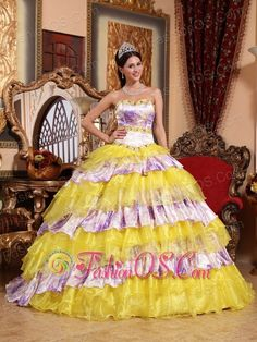 Inexpensive Multi-color Quinceanera Dress Sweetheart Organza Beading and Ruffles Ball Gown  http://www.fashionos.com  http://www.youtube.com/user/fashionoscom?feature=mhee   Star in your own fairytale at your 2012 quinceanera or formal in this quinceanera ball gown dress! The structured bodice with a modified sweetheart features dazzling beadings edged with the bust and waist, which accentuates your feminine qualities better than others.