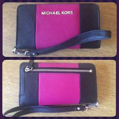 Michael Kors Saffiano Slim Tech Wallet/Wristlet MICHAEL KORS SAFFIANO LEATHER iPHONE CLUTCH WALLET WRISTLET Pre-Owned fantastic condition (Price is Firm) COLOR:  Black/Fushia (Deep Pink)  INTERIOR HAS 5 CREDIT CARD SLOTS AND OPEN SLIP OCKET I HAVE AN iPHONE 6 WHICH FITS INTO THE PHONE POCKET (without a case)  BACK ZIP POCKET.  6 X 3.5 X 1. Detachable Wristlet Strap Michael Kors Bags Clutches & Wristlets