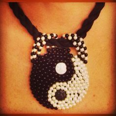Handmade jewelry. Beadwork ying yang necklace. Black and white pearls with silk cord. #handmade #jewelry #beadwork #necklace