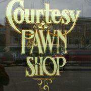 Courtesy Pawn Shop - Gold leaf window