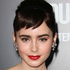 I love, love, love Lily Collins' bangs and bold brow.....very modern day Audrey Hepburn.