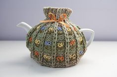 Hand knitted tea cosy with embroidery and ribbon by BittyCreations, £14.00