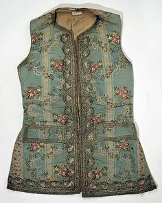 Waistcoat, France, c. 1760. Cream and blue striped silk brocaded with floal sprays, metal thread embroidery, metallic lace.