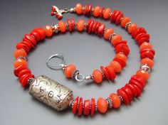Rare and old Tibetan metal repousse bead, red coral and orange jade by mshafran.