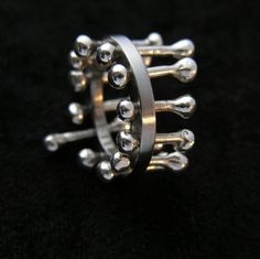 Ring is made of titanium and silver, silver parts are mobile - ARTIST: ARTUR SKROCKI VEL MACHINA