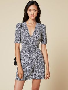 A new way to highlight your shoulders. This is a mini length, wrap dress with a…