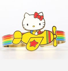 Up, up and away. This rainbow-esque Hello Kitty cuff adds a color pop to any outfit