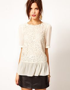the amount of white lace clothing i own is getting a little ridiculous, but the silhouette and peplum on this top is perfect.