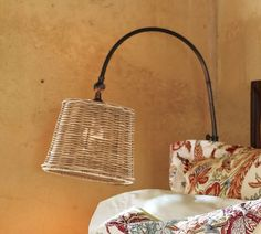 Adjustable Arc Sconce with Wicker Shade | Pottery Barn