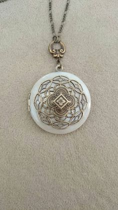 Check out this item in my Etsy shop https://www.etsy.com/listing/248888510/vintage-locket-necklace-pearly-white